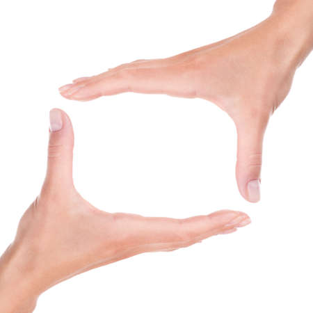 Two female hands framing a abstract frame square border isolated white background photo