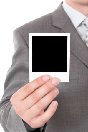 Man holds a instant photo. Focus on instant photo. photo