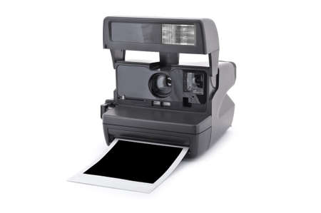 Vintage instant film camera with blank instant photo Isolated on a white background photo