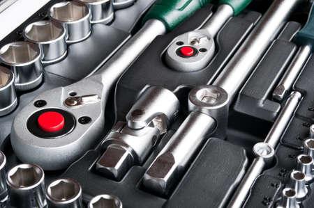 kit of metallic tools as background