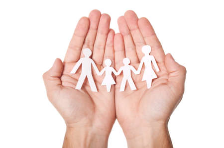 Paper family in hands isolated on white background photo