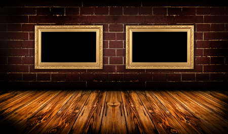 A dark, grungy room with gold frames on the wall Stock Photo - 10649174