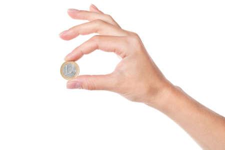 cash in hand: Mano 1 moneda de Euro, aislada sobre fondo blanco Foto de archivo