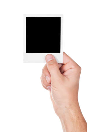 one instant photo in hand isolated on white background Standard-Bild