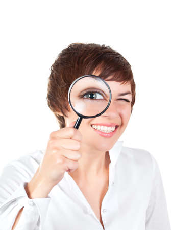 young smiling woman looking through magnifying glass isolated over white background Standard-Bild