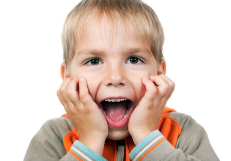 Child expressing surprise with his hands in his face isolated on white background photo