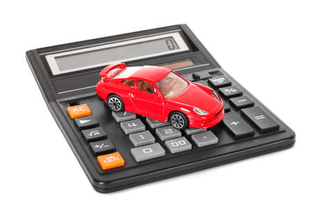 Calculator and red toy car isolated on white background photo