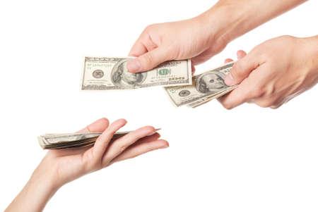 mano con dinero: Manos dando dinero aislada sobre fondo blanco Foto de archivo