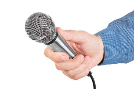 mics: Presentador sosteniendo un micr�fono en la mano aisladas sobre fondo blanco Foto de archivo