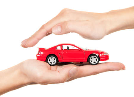 Red car in hands on a white background. Concept of safe driving Stock Photo - 11009786