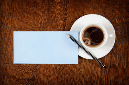 Blank card with pencil on coffee cup with space for your data photo