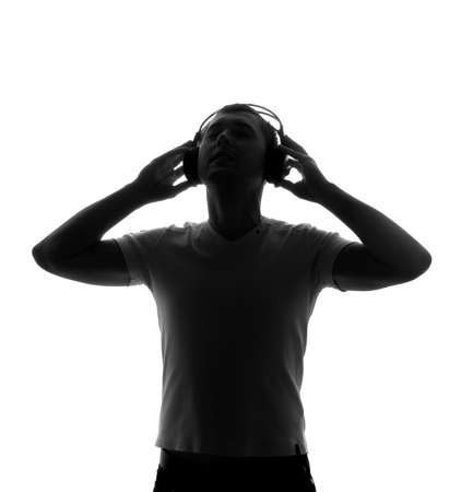Silhouette of DJ with headphones. Back light.
