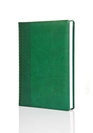 hardback: Blank green hardback book with ornament cover ready for text or graphic isolated on white