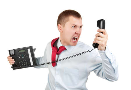 Businessman shouts on the phone on white background photo