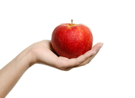 Beautiful female hand holding and showing a perfect red apple on white background Standard-Bild