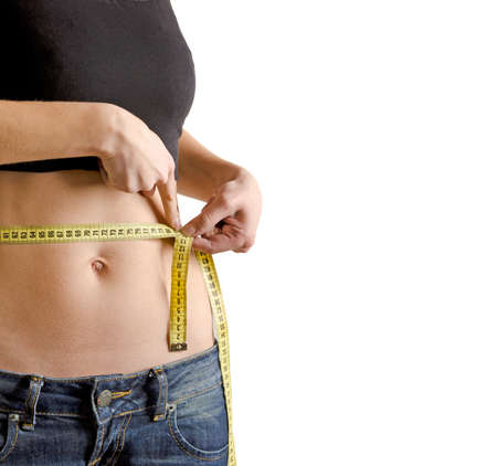 Woman measuring waistline with a tape isolated on white background