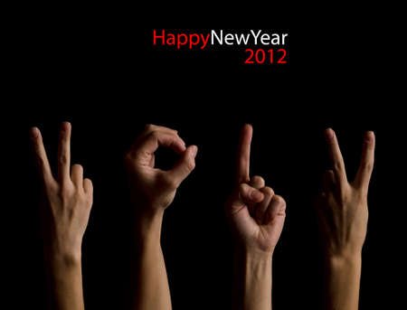The number 2012 shown by fingers in creative New Year greeting card Stock Photo - 11270236