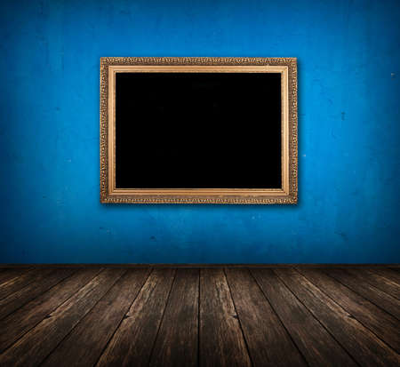 dark vintage blue room with wooden floor and golden frame hanging on the wall