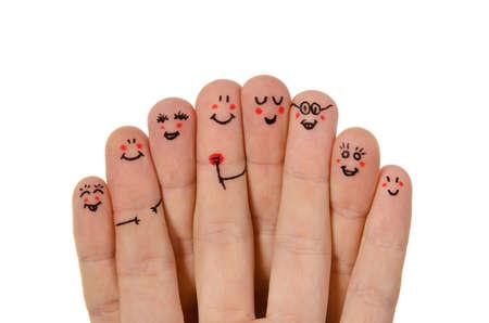 chicas divirtiendose: Feliz grupo de smileys dedo sobre fondo blanco Foto de archivo