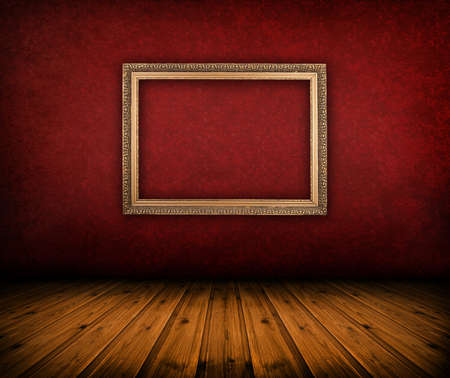 dark vintage red room with empty frame hanging on the wall photo