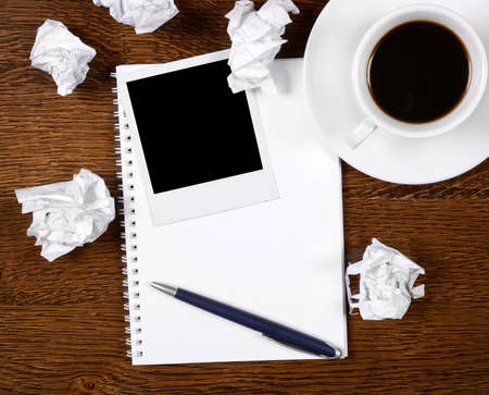 wads: Blank photo on notepad with pen on wooden desk