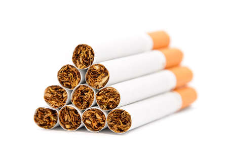 nicotine: Closeup of a pile of cigarettes over white background