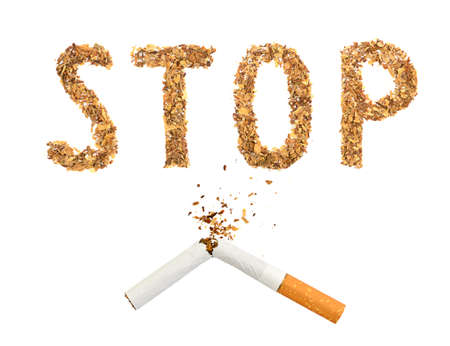 The broken cigaret and word stop made of tobacco isolated on white background