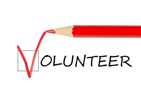 volunteering: Volunteer message and red pencil isolated on white background
