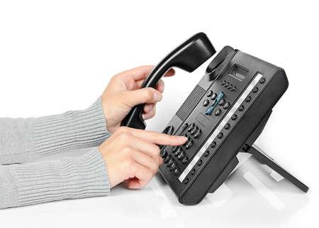 wijzerplaat: Handen van een jong meisje op de telefoon kiest het nummer Stockfoto