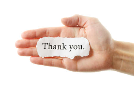 Thank you or thanks concept with hand word and paper  Isolated on white background