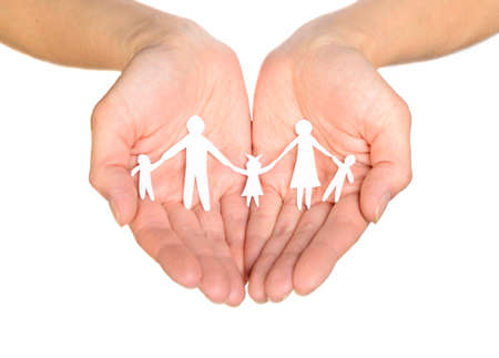 Paper family in hands isolated on white background Stock Photo - 12707504