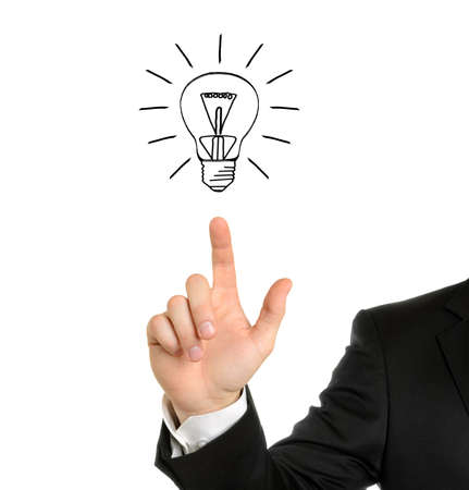 Business man hand drawing light bulb isolated on white  photo