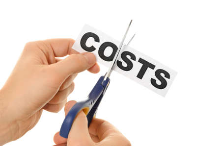 cutting costs: Scissors cutting the word costs concept for recession or credit crisis isolated on white background