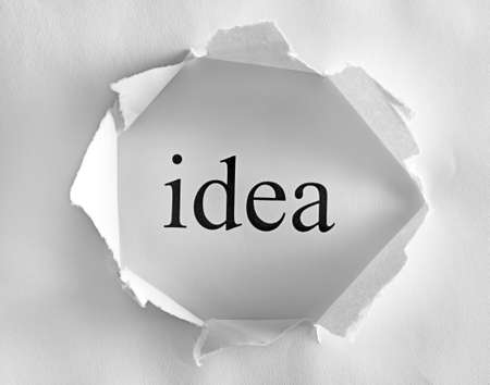 Idea on white background in a paper hole  photo