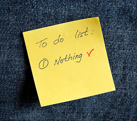 to do list: A yellow sticky note on a blue background Stock Photo