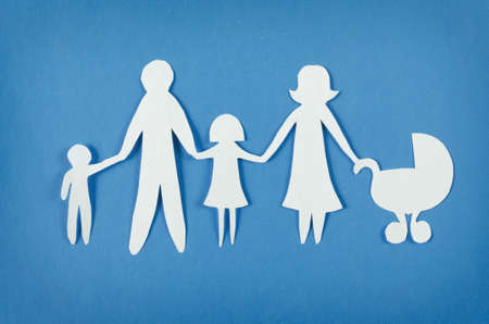 adopting: Closeup of happy paper family on blue background