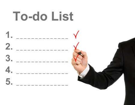 hacer: Empresario dibujo a mano una lista de tareas aisladas sobre fondo blanco Foto de archivo