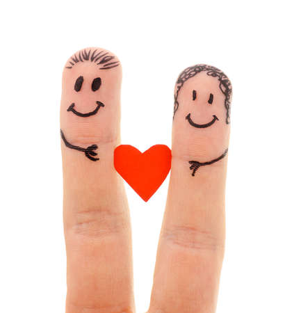 couple holding hands: A happy couple in love with painted smiley and hugging isolated on white background