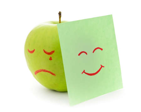Crying apple on white background. photo