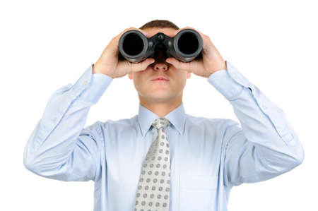Male looking with binoculars isolated on white background Stock Photo - 13023808