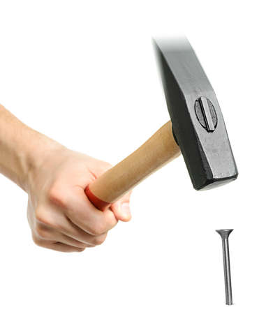 the hammer: Estudio aislado martillo golpeando un clavo, con el desenfoque de movimiento parcial en la parte superior de la herramienta