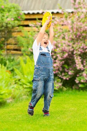 Little boy is playing Frisbee Stock fotó