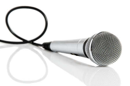 Silver microphone with black wire isolated on white  Stock Photo