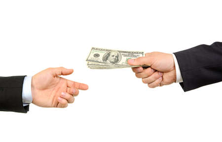 passing: Hand handing over money to another hand isolated on white background