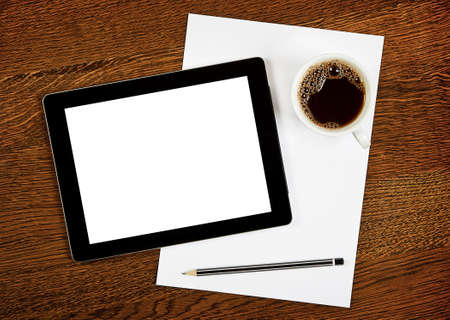 Workplace with blank digital tablet, paper, pen and cup of coffee on work table. Stock Photo - 14136364