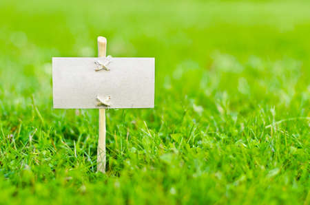 Empty signboard on green grass