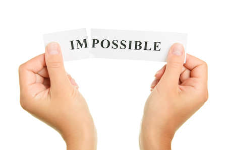 achievable: Word impossible isolated on white background Stock Photo