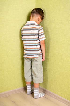 Little child boy wall corner punishment standing  Stock Photo