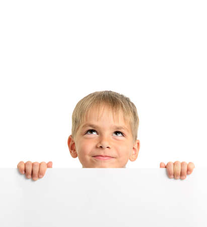 Cute boy holding white board and looking up, isolated on white Stock Photo - 15550850