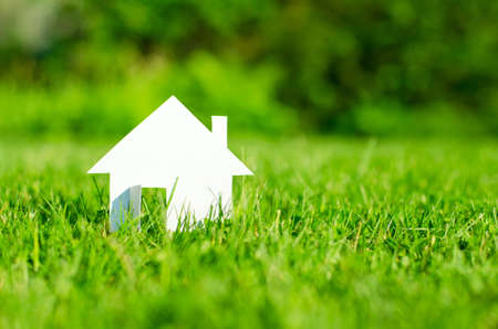 property agent: House in green field  Stock Photo